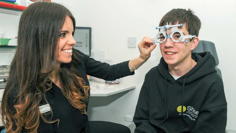 Optometrist Natalia Nowakowska with Mathew Lee