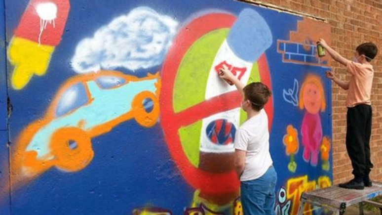 Young people in Lincoln paint a graffiti wall as part of a stop smoking project