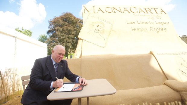 Councillor Colin Davie signing a Magna Carta. Photo: Steve Smailes for The Lincolnite