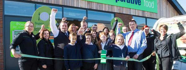 Pupils from South Hykeham community primary school help cut the ribbon at the grand opening of the new Co-operative store in North Hykeham