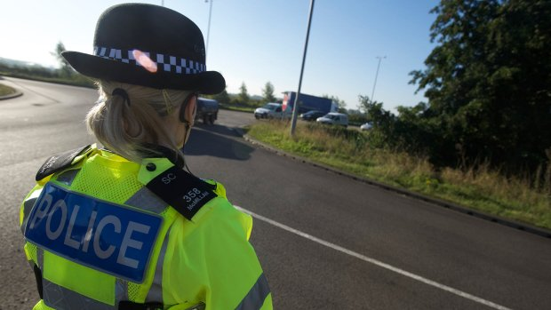 An officer at the checkpoint on the A46 near Thorpe-on-the-Hill. Photo: Steve Smailes for The Lincolnite