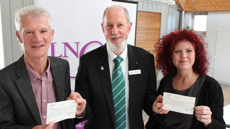 Philip Barnatt (left), Chairman of the Boultham Park Capital Appeal, and Victoria Bradshaw, of the Nomad Trust, receive the donations from Chris Trigg