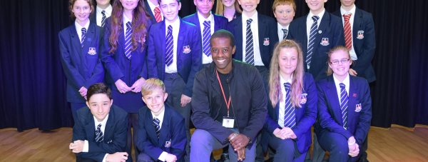 Hustle and Merlin star Adrian Lester with the children from Sir Robert Pattinson Academy