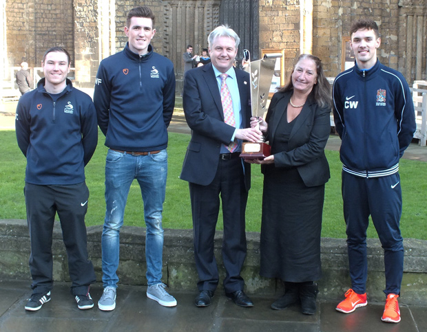 BGU's Vice Chancellor, the Rev Canon Professor Peter Neil, and University of Lincoln Vice Chancellor Professor Mary Stuart with the Cathedral Cup. Also pictured (left to right) are Matt Cunliffe and Will Fry from the University of Lincoln and Callum Ward from BGU.