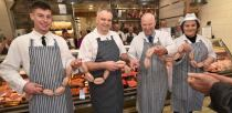 Staff at Fosters Butchers and Bakers celebrating the reopening of the shop. Photo: Steve Smailes for The Lincolnite