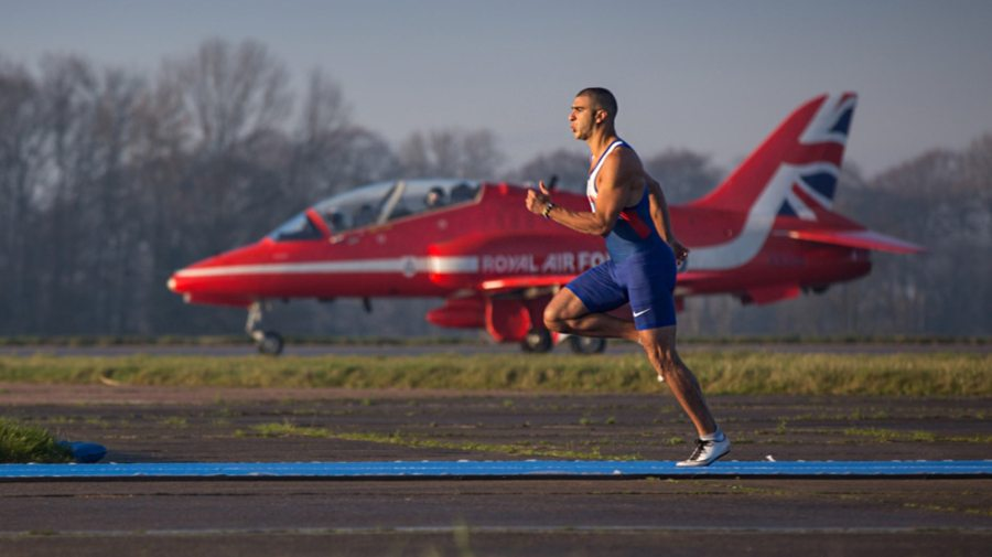 Olympic athlete Adam Gemili with a jet from the Royal Air Force Aerobatic Team, the Red Arrows, at RAF Scampton for ITV's new show, It's Not Rocket Science. Picture by SAC Gina Edgcumbe, MoD/Crown Copyright 2016.