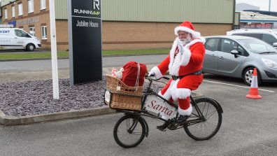 Santa joined the charity representatives to receive the giant cheque. Photo: Steve Smailes for The Lincolnite