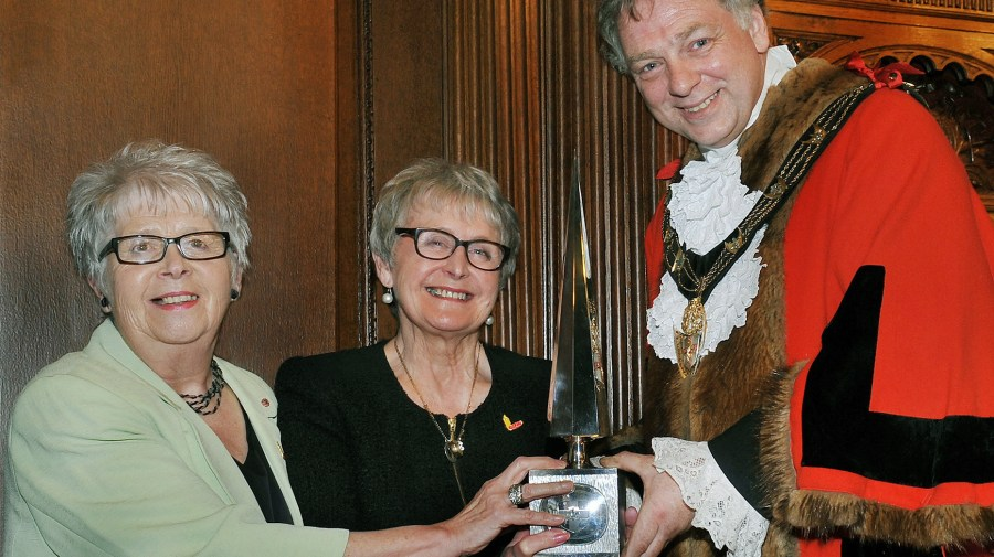 (L-R) Candles co-founders Pam Connock MBE and Dyllys Firth receiving the Civic Award from Lincoln Mayor Councillor Andy Kerry