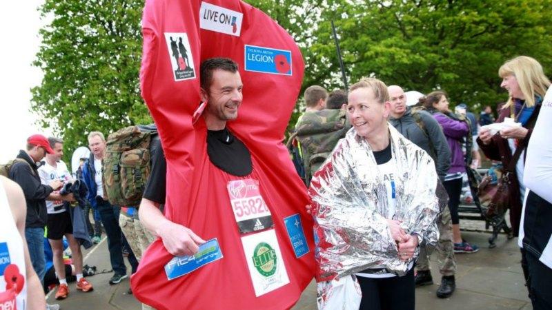 The couple ran the London Marathon dressed as poppies