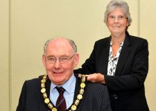 Councillor Gill Ogden handing over the reins as chairman to Councillor John Money. Photo: North Kesteven District Council