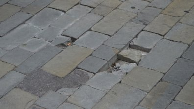 The stone used for the new cobbled road has begun to crack and sink.