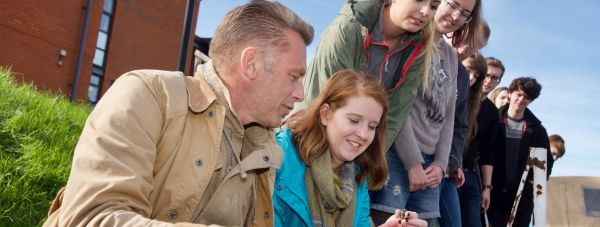 Chris Packham pond dipping with students from the University of Lincoln. Photo: Steve Smailes for The Lincolnite