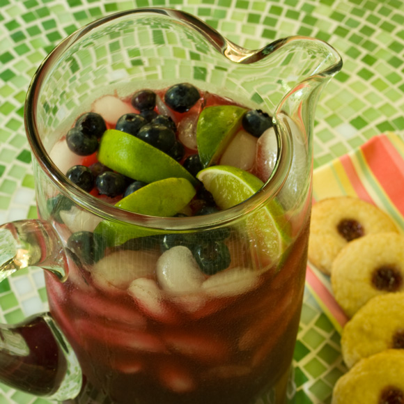 Fresh pitcher of blueberry lemonade with lemon cookies Fourth of July Independence Day Roundup