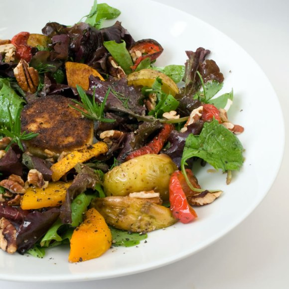Serving of fresh fall salad Roasted Fall Vegetable Salad with Warm Goat Cheese & Honey Mustard Vinaigrette