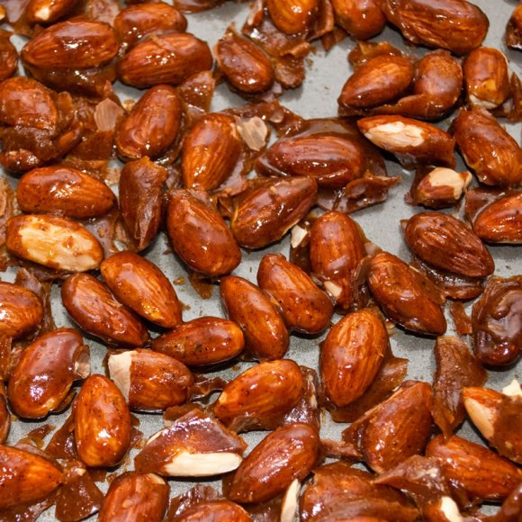 Carmelized almonds cooling in the pan Caramelized Ancho Chile & Cinnamon Almonds