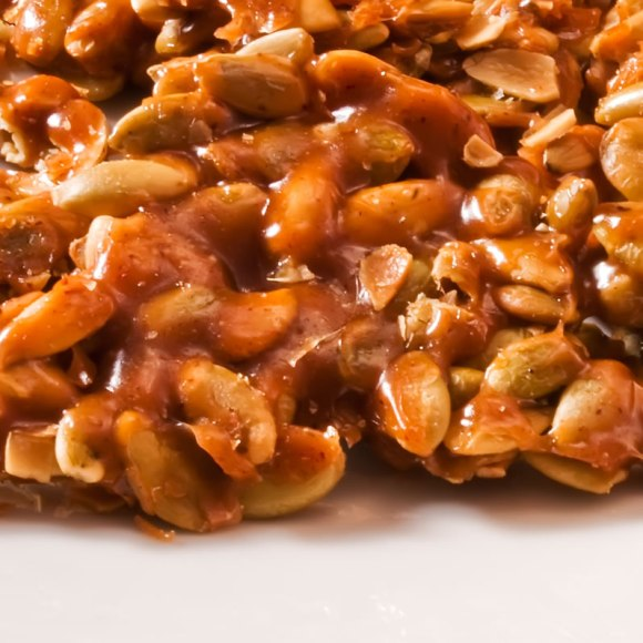 Carmelized pumpkin seeds closeup Caramelized Ancho Chile & Cinnamon Almonds
