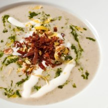 Roasted Garlic & Sunchoke Soup with Rosemary Hazelnut Pesto & Goat Cheese