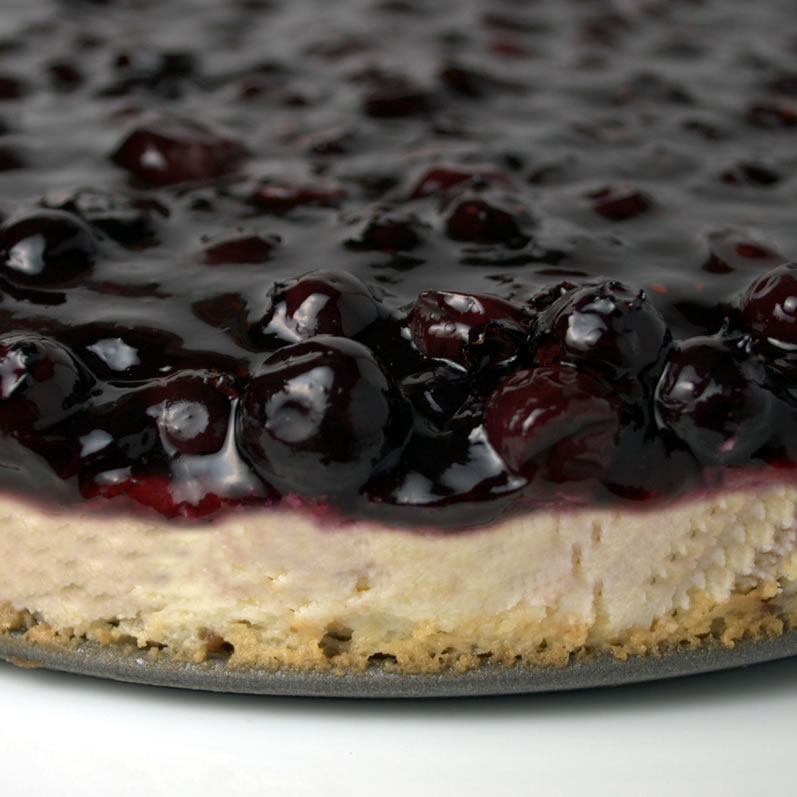 Closeup of Whole Blueberry, Lime & Rose Petal Cheesecake