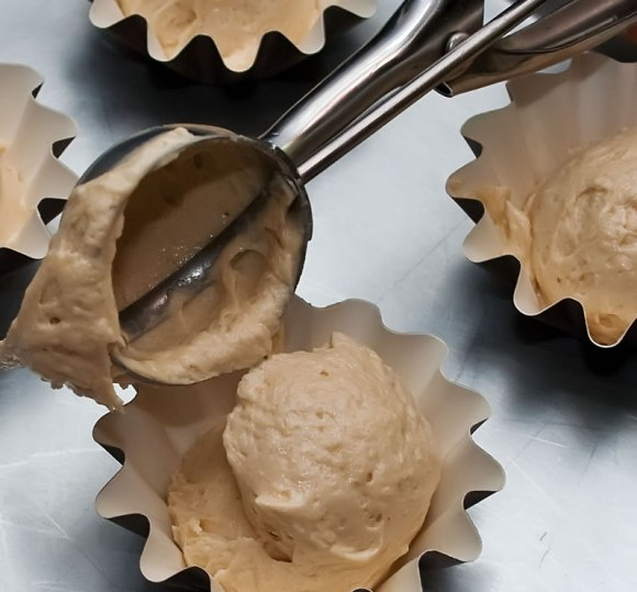 Scooping out the batter 2 Peanut Butter & Garam Masala Cupcakes with Creamy Dreamy Peanut Butter Frosting, Peanut Praline & Caramelized Banana