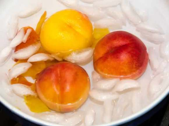 Blanched Peaches in Ice Water Ginger Lime Peach & Blueberry Crisp with Toasted Hazelnut Streusel