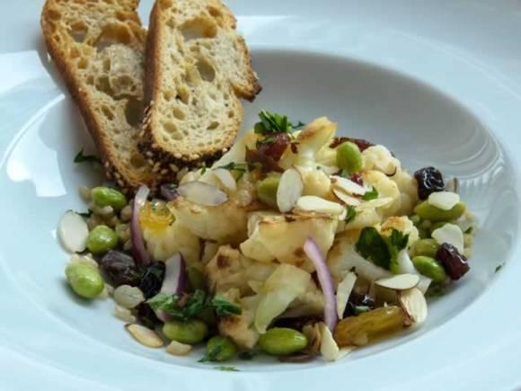 Serving 1 Warm Cauliflower Salad with Edamame & Raisins