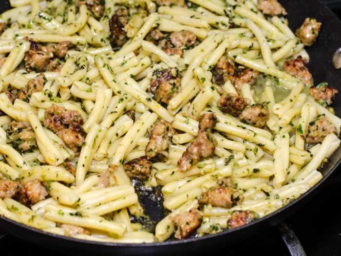 Cooked Strozzapreti, Fava Beans Greens Pesto & Italian Sausage
