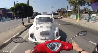 Dramatic video shows scooter smash into back of VW Beetle after rider looks away for just a SECOND