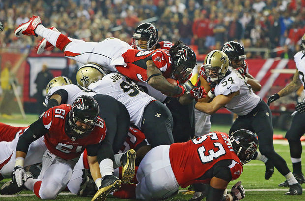 Atlanta Falcons running back Steven Jackson goes over the top into the end zone for a touchdown during the first half of an NFL football game against the New Orleans Saints, Thursday, Nov. 21, 2013 in Atlanta. (AP Photo/Atlanta Journal-Constitution, Curtis Compton)