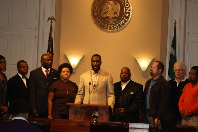 Ward 6 City Councilman Tony Yarber speaks at the press conference, flanked by pastors, ministers and community leaders.