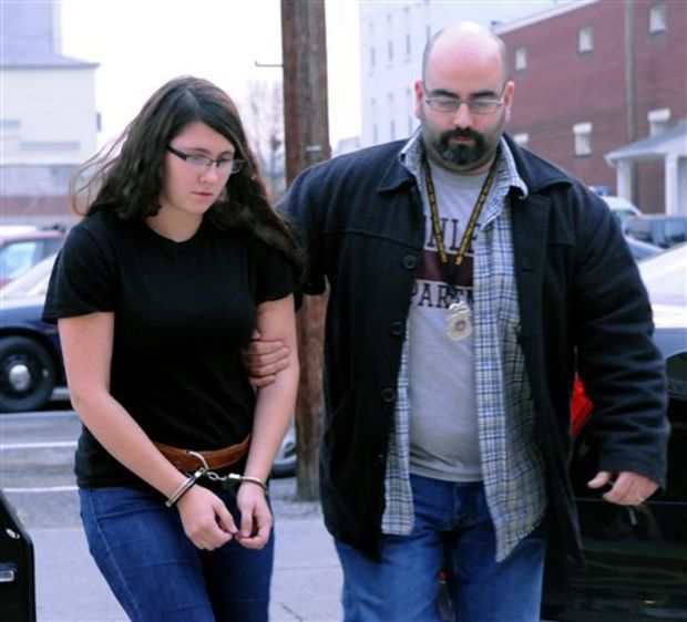 Miranda K. Barbour is led into District Judge Ben Apfelbaum's office in Sunbury, Pa., by Sunbury policeman Travis Bremigen on Tuesday. Barbour and her husband, Elytte Barbour, are charged in the murder of Troy LaFerrara, whose body was found in a backyard in Sunbury, in November. (The Associated Press)