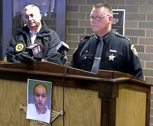 Sheriff Travis Hutchinson, right, speaks with reporters as Jim Ciotti of the Ohio Bureau of Criminal Investigation looks on, during a news conference at the Wayne County Justice Center in Wooster, Ohio, Sunday, Dec. 15, 2013. Jerrod Metsker, 24, was arrested at his home on a murder charge about 12 hours after deputies found the body of Reann Murphy near her home at a mobile park in Smithville, about 30 miles southwest of Akron, Hutchinson said. Reann was last seen Saturday night playing outdoors at the park. Officers, firefighters and neighbors joined in the search for Reann, going door-to-door and combing area properties. Hutchinson wouldn't say how Reann was killed or offer a motive. He described Metsker as a family friend and neighbor. (AP Photo/Akron Beacon Journal, Mary Beth Breckenridge)
