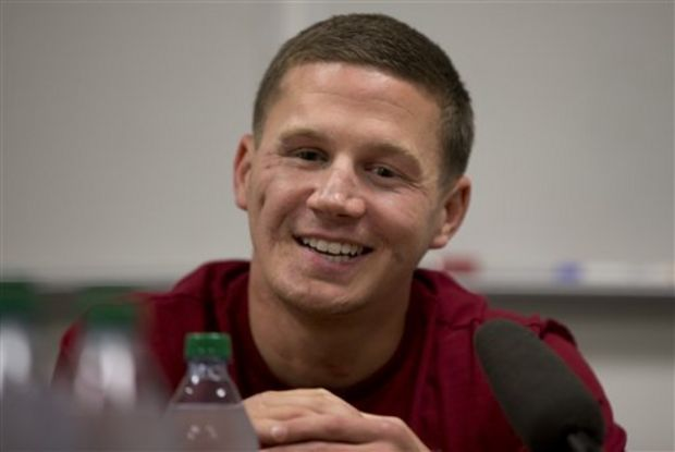 This photo taken May 13, 2014 shows Medically retired Marine Lance Cpl. Kyle Carpenter speaking to media at the Pentagon. On June 19, 2014, President Barack Obama will award Carpenter the Medal of Honor for his courageous actions while serving as an Automatic Rifleman with Company F, 2d Battalion, 9th Marines, Regimental Combat Team 1, 1st Marine Division (Forward), I Marine Expeditionary Force (Forward), in Helmand Province, Afghanistan. (AP Photo/Carolyn Kaster)