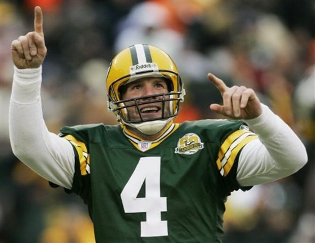 In this Dec. 9, 2007 file photo, Green Bay Packers quarterback Brett Favre reacts to a 46-yard touchdown pass to tight end Donald Lee during the second half of an NFL football game against the Oakland Raiders in Green Bay, Wis. Favre will be inducted into the team's Hall of Fame and have his jersey retired next year. Favre writes on his official website that it will be an honor to have his name placed among others such Bart Starr, Curly Lambeau, Ray Nitschke and Vince Lombardi, to name a few. (Morry Gash/The Associated Press)