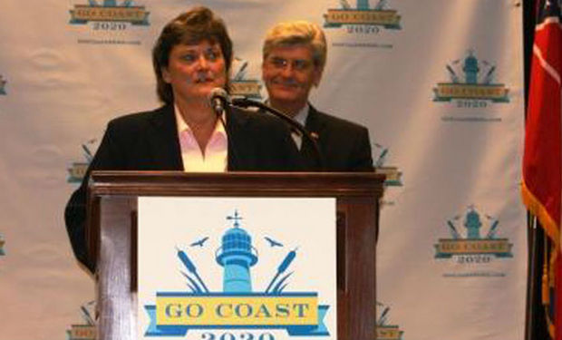 Trudy Fisher, executive director of the Mississippi Department of Environmental Quality, speaks at the Mississippi Coast Coliseum and Convention Center on Wednesday, Aug. 22, 2012, as Gov. Phil Bryant looks on. Fisher, no longer with DEQ, has been hired as a consultant. (file photo)