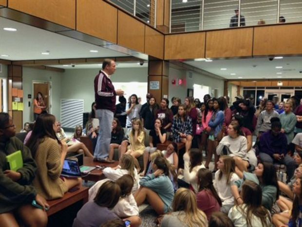 In this Oct. 5, 2014 photo provided by Mississippi State University, Mississippi State President Mark E. Keenum speaks with students at the university's Oak Hall as part of the institution's immediate response to make accommodations for affected students by the Oak Hall fire in Mississipi State, Miss. The university said nobody was injured, but more than 150 students stayed elsewhere Sunday night after a fire began around 8 p.m. in one wing of Oak Hall, which opened in 2012. (AP Photo/Mississippi State University, Sid Salter)