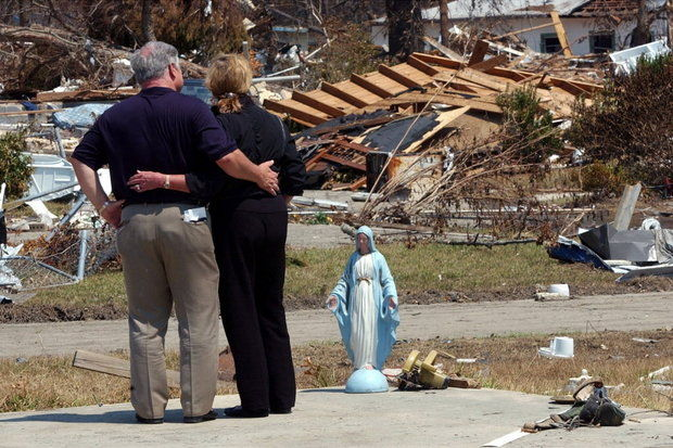 Former Mississippi Gov. Haley Barbour and ex-first lady Marsha Barbour look over Hurricane Katrina damage in Biloxi, Mississippi in this September 2005 file photo. The former governor is now promoting his book that offers a first-person account of the year following the deadly natural disaster. (File/Tim Isbell)