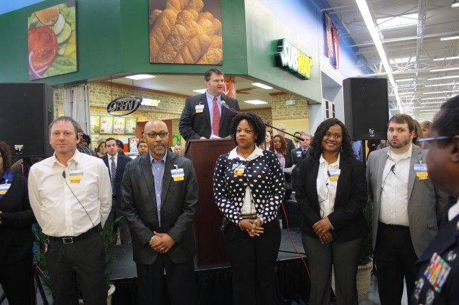 Lee Maddox, store manager of Byram's new Walmart Supercenter, presents members of the store's management team Wednesday morning during the grand opening. Photo by Shanderia K. Posey