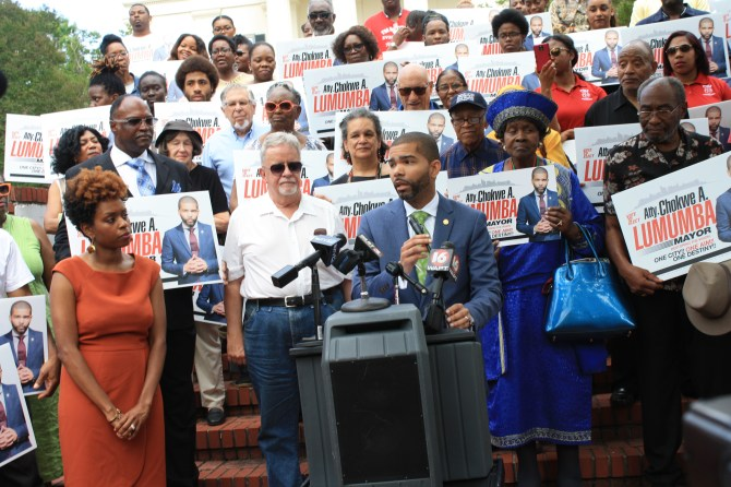 Attorney Chokwe Antar Lumumba speaks to supports and the media while announcing his candidacy for mayor of Jackson. His wife, Ebony Lumumba is at left. PHOTO BY SHANDERIA K. POSEY