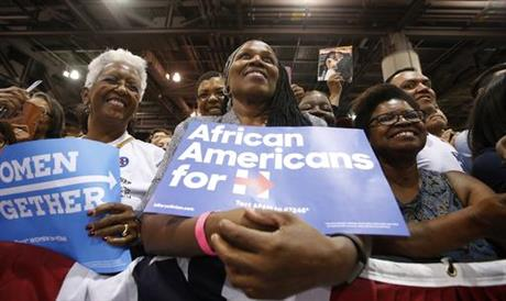 Supporters listen to first lady Michelle Obama as she speaks during a campaign rally for Democratic presidential candidate Hillary Clinton Thursday, Oct. 20, 2016, in Phoenix. (AP Photo/Ross D. Franklin)