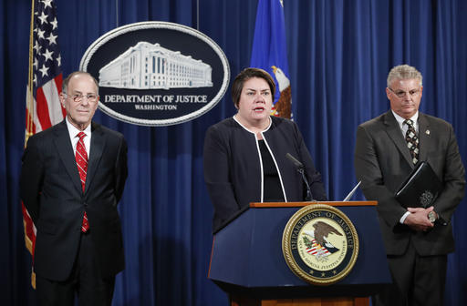 Assistant Attorney General Leslie R. Caldwell, center, of the Criminal Division; Kenneth Magidson, left, of the Southern District of Texas; and Bruce M. Foucart, director, National Intellectual Property Rights Coordination Center, participate in a news conference at the Justice Department in Washington, Thursday, Oct. 27, 2016. Justice Department is announcing charges in connection with a call center operation said to be based in India. Federal prosecutors have unsealed an indictment charging 61 defendants in the United States and abroad, including five call center groups. The department says the extorted funds ended up being laundered with the help of prepaid debit cards. Arrests are taking place throughout the United States. (Pablo Martinez Monsivais/The Associated Press)