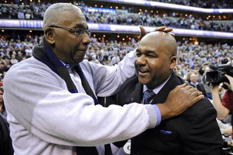 In this March 9, 2013, file photo, former Georgetown coach John Thompson Jr., left, congratulates his son Georgetown head coach John Thompson III, right, after the Hoya's 61-39 win over Syracuse in an NCAA college basketball game in Washington. Georgetown has fired basketball coach John Thompson III on Thursday, March 23, 2017, after two consecutive losing seasons at the school his father led to a national championship. (AP Photo/Nick Wass, File)