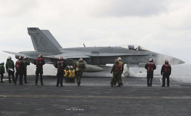 In this March 14, 2017 file photo, an F/A-18 fighter prepares to take off from the deck of the Nimitz-class aircraft carrier USS Carl Vinson during the annual joint military exercise called Foal Eagle between South Korea and the United States at an unidentified location in the international waters, east of the Korean Peninsula. (AP Photo/Lee Jin-man, File)