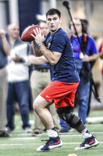 Former Mississippi quarterback Chad Kelly throws during the University of Mississippi's Ole Miss NFL Pro Day, at the Manning Center in Oxford, Miss., Monday, April 3, 2017. (Bruce Newman, Oxford Eagle via AP)