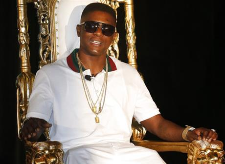 In this March 10, 2014 file photo, rapper Lil' Boosie, whose real name is Torence Hatch, appears at a news conference in New Orleans. Six men have been arrested after rapper Boosie Badazz attracted an unruly crowd Sunday, April 9, 2017 while shopping at a Mississippi mall. (AP Photo/Bill Haber, File)