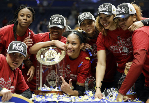 South Carolina forward A'ja Wilson, center, and teammates pose with their trophy after defeating Mississippi State in the NCAA college basketball championship game at the women's Southeastern Conference tournament, Sunday, March 4, 2018, in Nashville, Tenn. (AP Photo/Mark Humphrey)