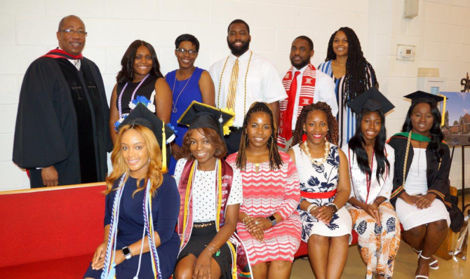 Pastor Williams with college and advanced degree recipients