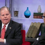 Doug Jones and Benjamin Chavis Jr. in conversation.