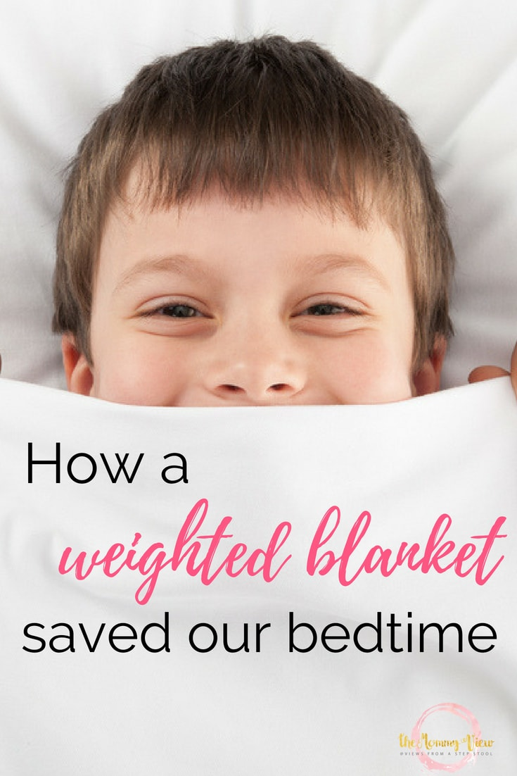 boy in bed under blanket with text overlay 'how a weighted blanket saved our bedtime'