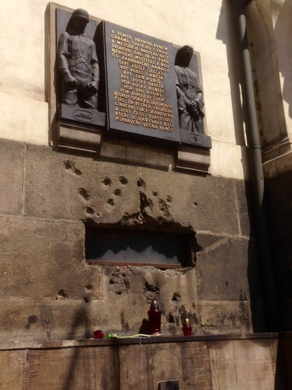 The wall of Sts. Cyril and Methodius church where the final shoot-out happened. Bullet holes frame the vent in the wall in which the fire department flooded the crypt. The plaque commemorates the battle and sacrifice. Ultimately, the priest, the bishop and the leaders of the church and their families were executed by the Nazis for harboring the Czech paratroopers.