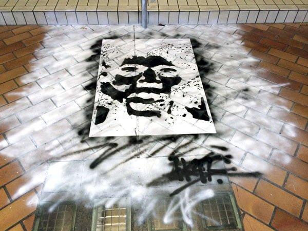 Eminent Takeover - Street Art Face on Floor